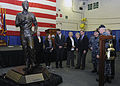 A bronze statue honoring President Gerald R. Ford is unveiled during a ceremony in the ship's hanger bay. (26214592632).jpg