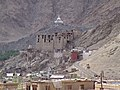 A combined view of the old Leh Palace with the modern day Shanti Stupa in the background.jpg