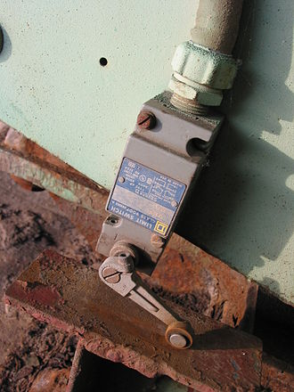 Limit switch - A limit switch mounted on a moving part of a bridge.