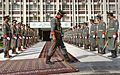 A member of the Afghanistan Army's honor cordon rolls out red carpet.jpg