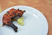 A piece of a tandoori chicken.JPG