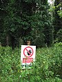 A sign lurking in the nettles - geograph.org.uk - 1408256.jpg