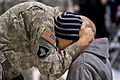 A soldier shares a hug and says his goodbye during a farewell ceremony at McEntire Joint National Guard Base 130126-Z-XH297-545.jpg
