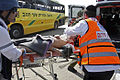 A wounded Israeli was treated by medics at the site Thursday.jpg
