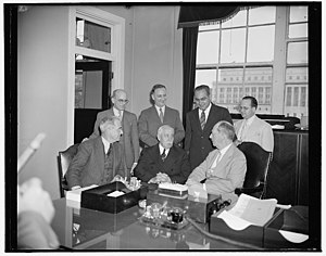 William D. Leahy - Admiral Leahy confers with Puerto Rican officials. Left to right: Rafael Martínez Nadal, Santiago Iglesias, Admiral Leahy, standing; Fernando Geigel, Alfonso Valdez, Bolivar Pagan, and Luis Obergh