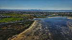 Aerial vista of the Melbourne CBD from Altona Coastal Park.jpg
