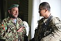 Afghan National Army Maj. Rahmatullah, left, with the 203rd Corps, talks with a U.S. Army major assigned to the 10th Mountain Division during a combined arms rehearsal at Forward Operating Base Thunder in Paktia 140303-A-IY570-115.jpg