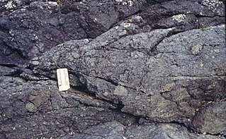 Agglomerate Coarse accumulation of large blocks of volcanic material that contains at least 75% bombs
