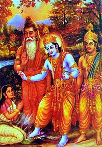 A white sari clad, young Ahalya sits with folded arms in left bottom corner. A blue-hued Rama (central figure) in a yellow dhoti touches his right foot to her, as he blesses her with her right hand and holds a bow in his left. A bearded, saffron-robed Vishvamitra stands to his left. Lakshamana stands to his right.