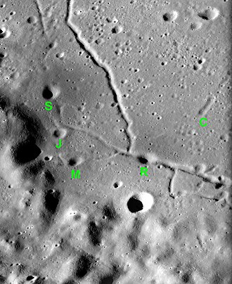 Alphonsus (crater) - Oblique view of the five small named craters: C = Chang-Ngo, R = Ravi, M = Monira, J = Jose, S = Soraya.  Facing south with sun illuminating from left. North on the photo is on the bottom