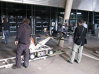 Camera dolly - Camera dolly mounted on track with an Arriflex D-21 camera