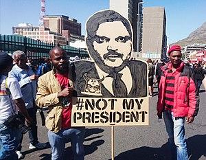 Gupta family - Image: Atul Gupta protest banner Cape Town Zuma must fall