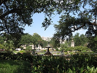 Audubon Park (New Orleans) - One of the fountains at Audubon Park with Tulane University in the background.