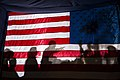 Barack Obama silhouetted behind flag in Dubuque.jpg