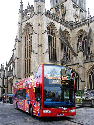 Open top buses in the United Kingdom - City Sightseeing tour bus in Bath, Somerset, an Optare Visionaire with Volvo chassis operated by the Bath Bus Company (outside Bath Abbey, December 2010)