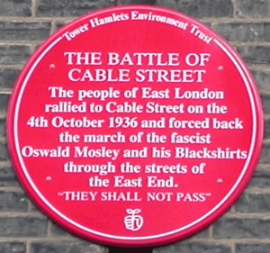 Cable Street - Red plaque in Dock Street commemorating the Battle of Cable Street.