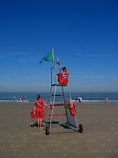 1f52a2a17b7 Belgian lifeguards with portable high chair to afford optimum viewing  position of bathing area