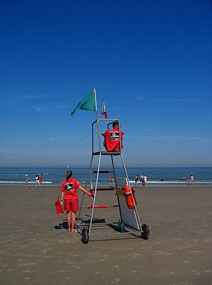 (caption from original) Lifeguards at work on ...