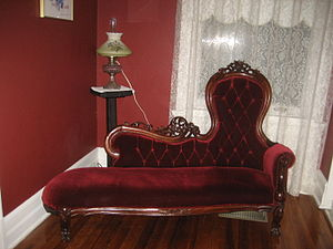 Fainting couch - Red upholstered fainting couch.