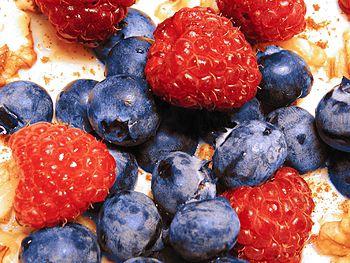 Breakfast of raspberries, blueberries and oatmeal.