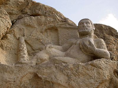 Hellenistic-era depiction of the Zoroastrian divinity Bahram as Hercules carved in 153 BCE at Kermanshah, Iran.