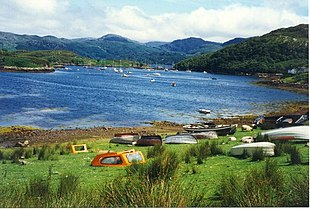 Boats pulled up on the grass at Badachro