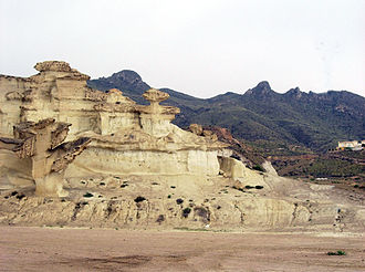 The southeasternmost end of the Iberian peninsula features an arid climate. In the image, Murcia region Bolnuevo-sierra-moreras.jpg