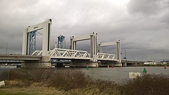 Vertical-lift bridge - The Botlek bridge in Rotterdam has two lifting spans of 87×50 m (95×55 yd), each with a surface area approaching a football field.