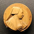 Boxwood medallion with portrait of a woman.jpg