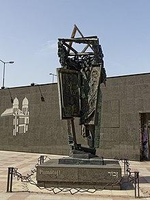 black metal memorial in an urban square