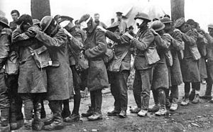 "168th (2nd London) Brigade - British soldiers blinded by poison gas. Vera Brittain commented: ""Great mustard-coloured blisters, blind eyes, all sticky and stuck together, always fighting for breath, with voices a mere whisper, saying their throats are closing and they know they will choke."""
