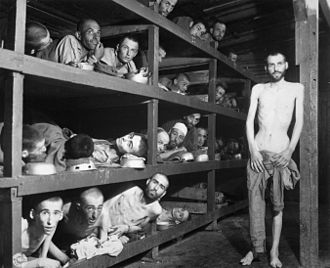 Internment - Jewish slave laborers at the Buchenwald concentration camp near Weimar photographed after their liberation by the Allies on 16 April 1945. Elie Wiesel is seen second row from bottom, seventh figure from the left.