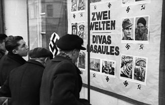 "The Holocaust in Latvia - ""Two Worlds"": An anti-communist and anti-semitic propaganda board, Latvia, Summer, 1941."