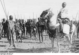 Mandara Kingdom - Sultan Bukar Afade (on horse) with a following of his people, c.1911/15.