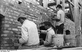 Repointing - German masons repointing a wall in 1948.