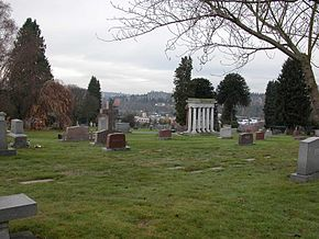 Calvary Cemetery in Ravenna/Bryant with University of Washington residence towers in background.