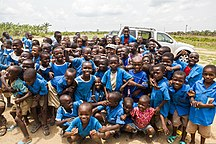 Cameroon-Education and health-Cameroonian school children gather around U.S. Army Master Sgt. John Reid, center, for a group photo near Douala, Cameroon, March 19, 2014, during Central Accord 14 140319-A-PP104-039