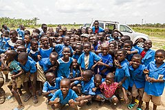 Cameroonian school children gather around U.S. Army Master Sgt. John Reid, center, for a group photo near Douala, Cameroon, March 19, 2014, during Central Accord 14 140319-A-PP104-039