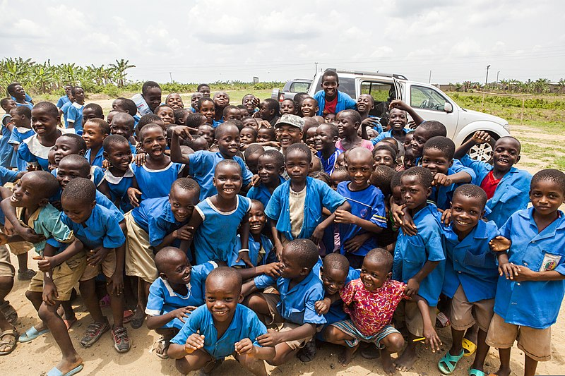 Cameroonian school children gather around U.S. Army Master Sgt. John Reid, center, for a group photo near Douala, Cameroon, March 19, 2014, during Central Accord 14 140319-A-PP104-039.jpg