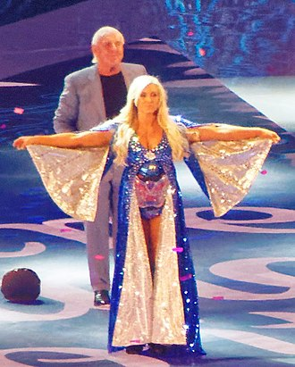 Charlotte Flair - Flair making her entrance alongside her father at WrestleMania 32