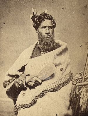 Mere (weapon) - Maori chief holding a Mere weapon (1860–1879)