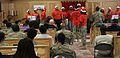 Choir rings aloud during the holiday season 121223-A-TT250-010.jpg