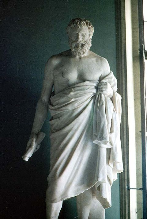 Statue of an unknown Cynic philosopher from the Capitoline Museums in Rome. This statue is a Roman-era copy of an earlier Greek statue from the third century BC. The scroll in his right hand is an 18th-century restoration. Cinico Capitolini.jpg