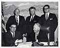 Civil Defense Leaders. Seated- Laurie J. Commier, Mayor John F. Collins. Rear (l-r)- John N. Levins, Charles J. Harvis, and John Theary (13846971243).jpg