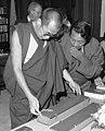 Close detail, Tenzin Gyatso, 14th Dalai Lama in 1979 (left) with Lobsang Phuntshok Lhalungpa looking at Tibetan books or Pecha at the Library of Congress on 11 September 1979, from- Dalai Lama visits LOC (cropped) (cropped).jpg