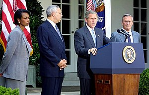 Condoleezza Rice - Rice, Secretary of State Colin Powell, and Secretary of Defense Donald Rumsfeld listen to President George W. Bush speak about the Middle East on June 24, 2002