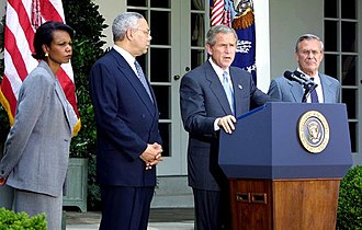 Colin Powell - Powell, National Security Advisor Condoleezza Rice and Secretary of Defense Donald Rumsfeld listen to President George W. Bush speak.