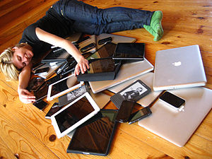 English: A woman cuddling a pile of digital de...