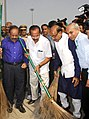 D.V. Sadananda Gowda and the Union Minister for Health and Family Welfare, Dr. Harsh Vardhan participating in the cleaning drive at the New Delhi Railway Station, during the Swachh Bharat Mission, in New Delhi.jpg