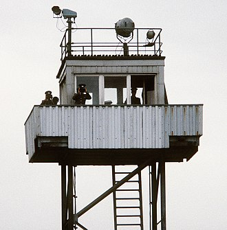 Schießbefehl - Three Border Troops guards in a watch tower on the Inner German border in 1984.